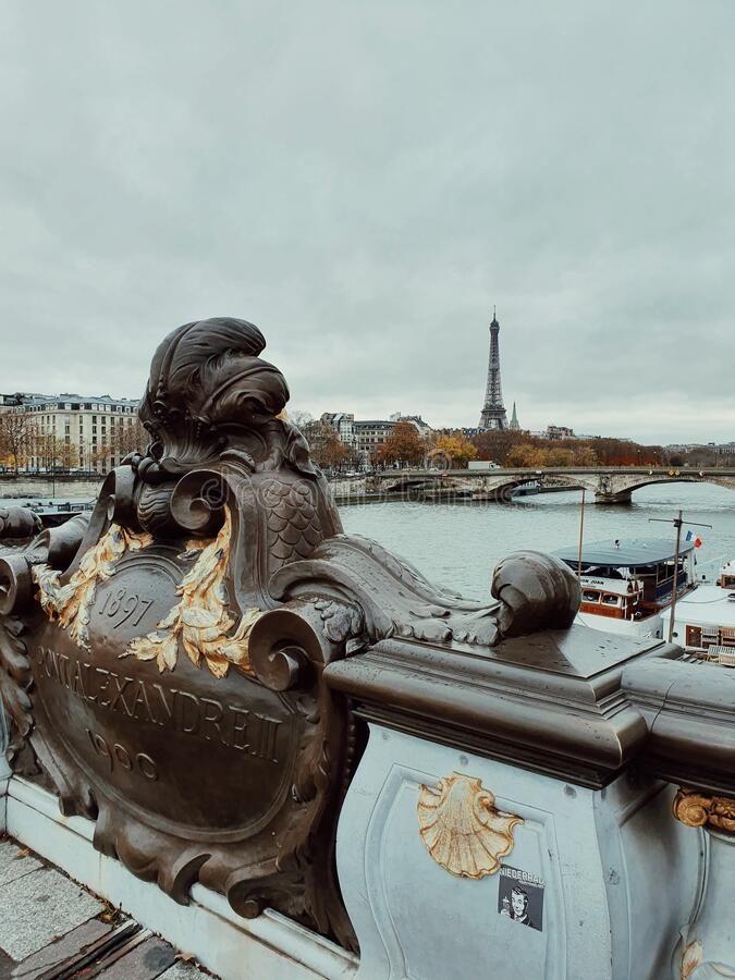 The Eiffel tower from the Alexandre III bridge, two famous momuments in the center of Paris, France stock photography