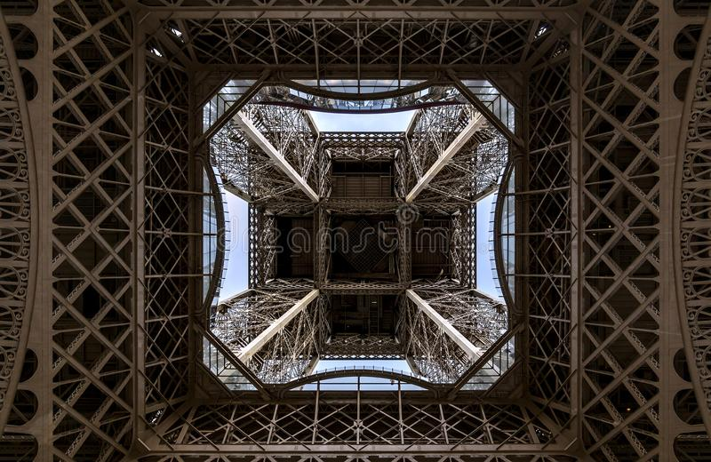 Eiffel tower from below in Paris royalty free stock photography