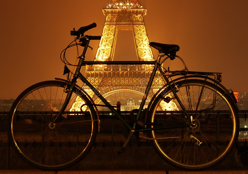 Eiffel tower and a bicycle at royalty free stock images