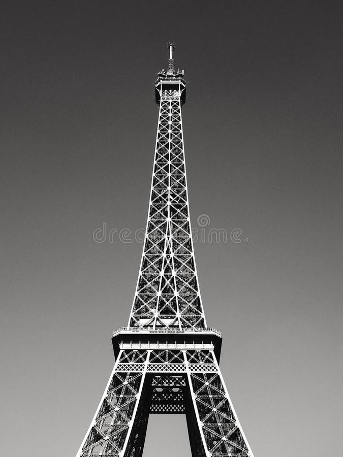 Eiffel Tower Black & White. Lovely view of the top of the Eiffel Tower. A black and white high contrast and detail stock image