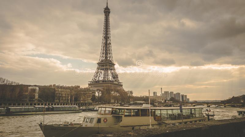 Eiffel Tower and boat retro from bridge stock images