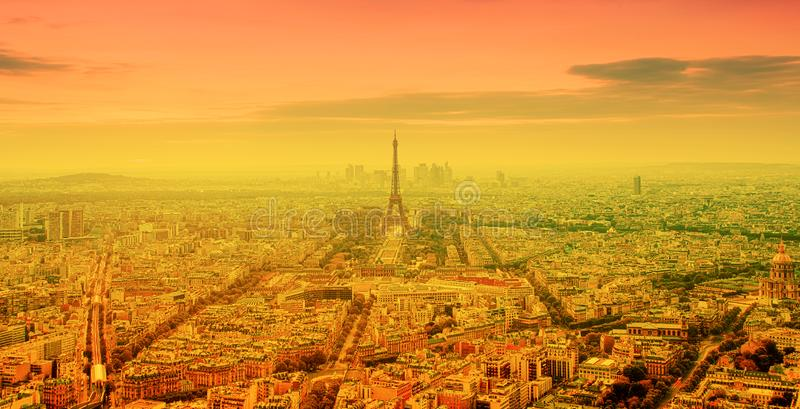 eiffel tower and bright sun on orange - heat wave in Paris, France stock photos
