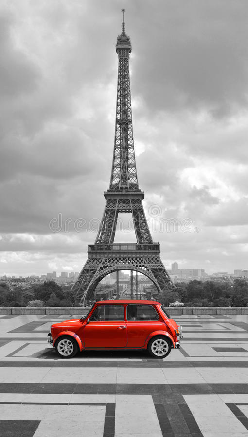 Eiffel tower with car. Black and white photo with red element. Eiffel tower view from the street of Paris. Black and white photo with red element