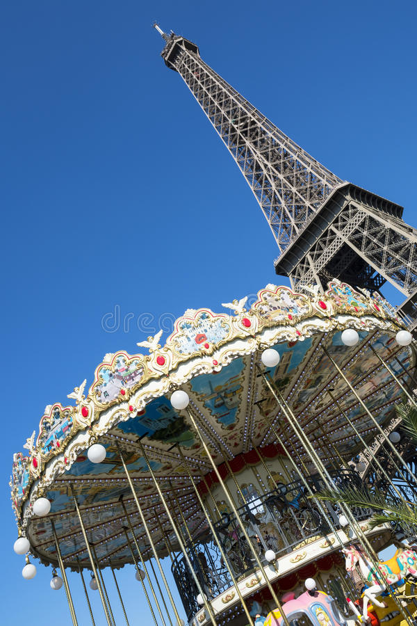 Eiffel tower and carousel stock images