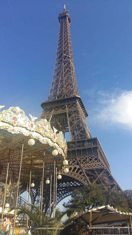 Eiffel Tower, Carousel, Sunny day in the city of the lights stock photography