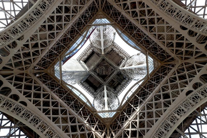 Eiffel Tower centered looking upward from ground level stock images