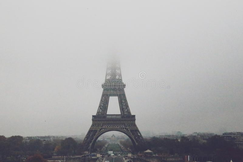 Eiffel Tower on a cloudy day stock images