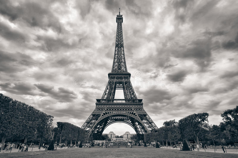 Eiffel tower with dramatic sky monochrome black an royalty free stock image