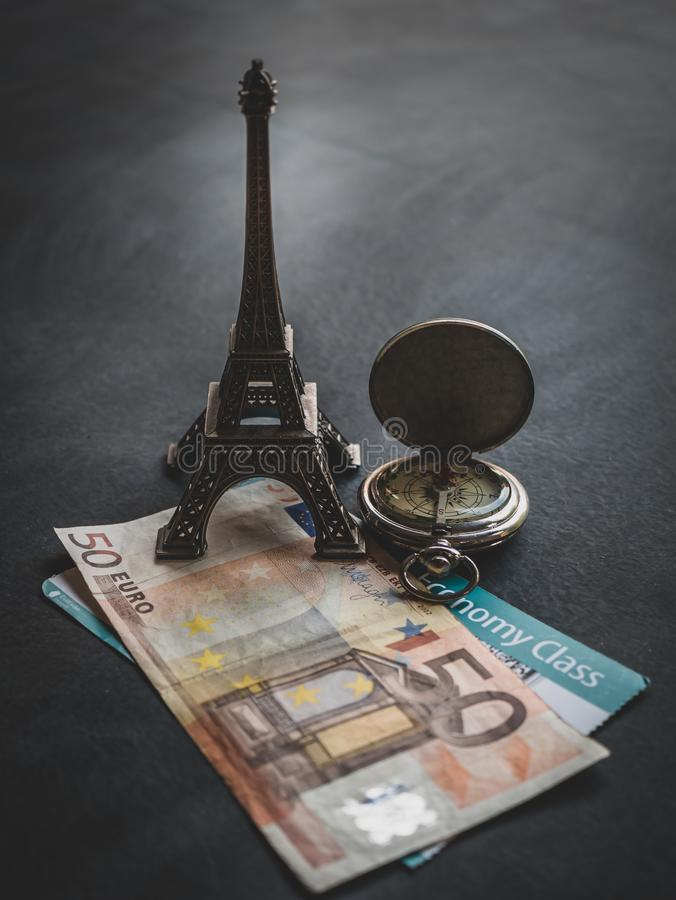 Eiffel tower with 50 euro banknote and boarding pass. Travel concept - Eiffel tower with 50 euro banknote and boarding pass finance journey map passenger sign stock images