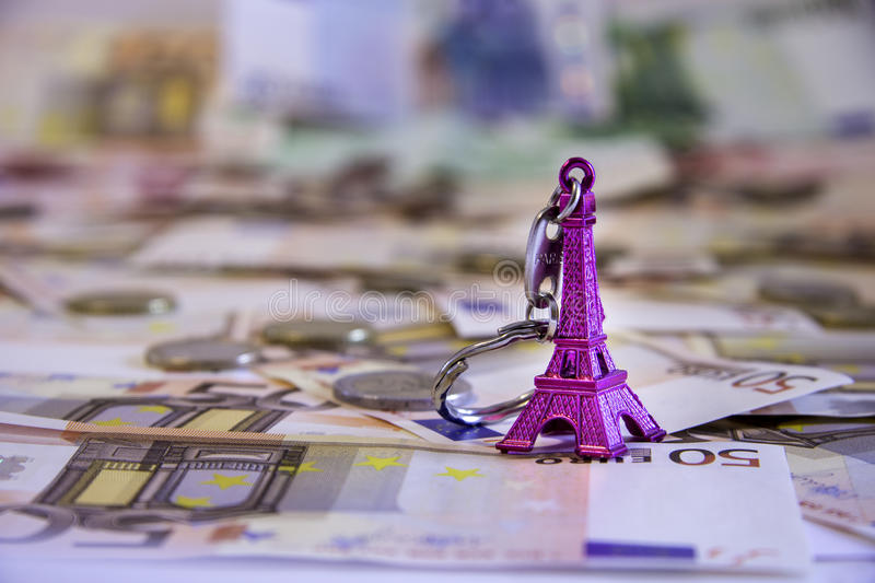 Eiffel tower french tourist gift with money stock photos