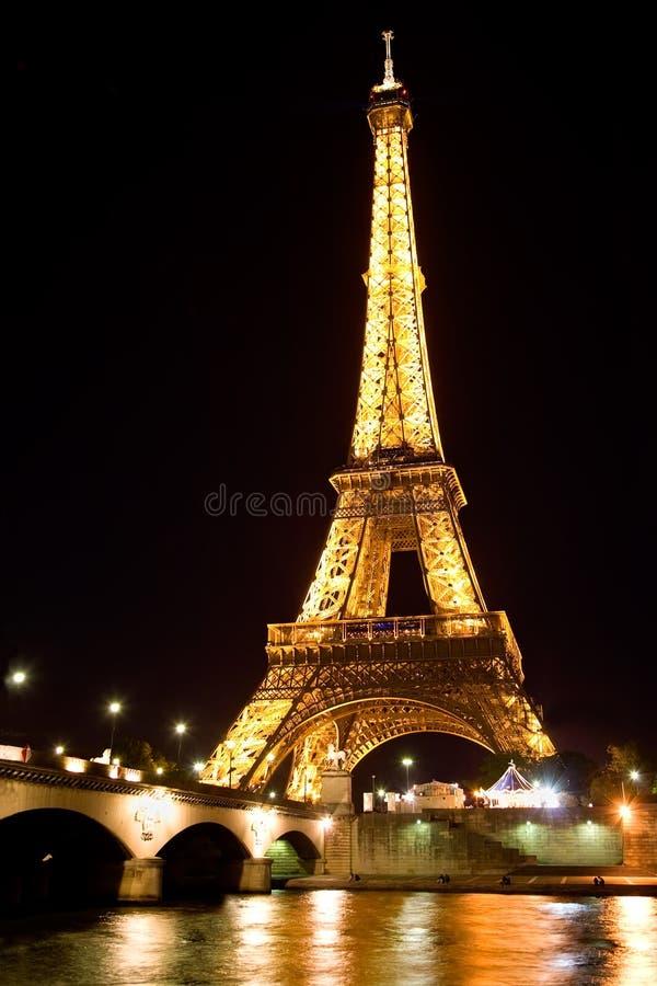 Eiffel tower illuminated at night royalty free stock image