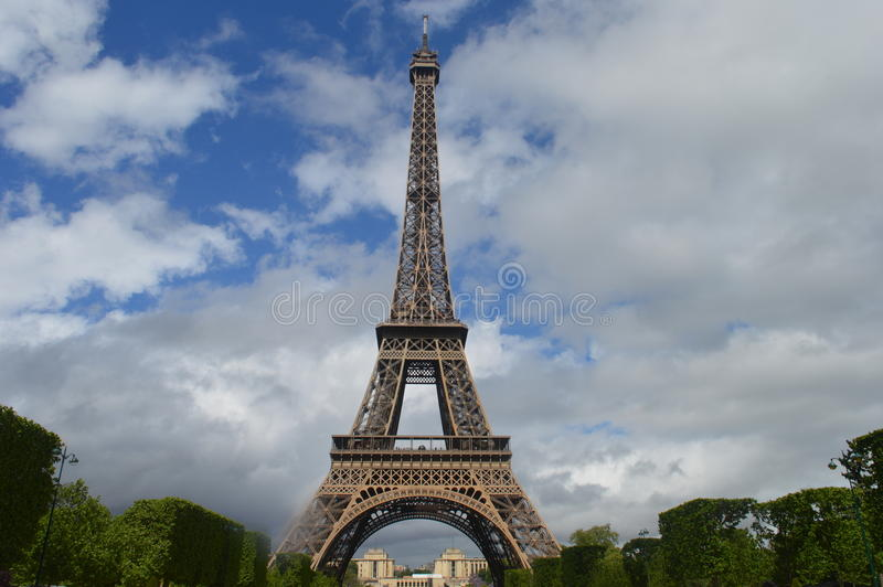 Eiffel Tower. It is an iron lattice tower located on the Champ de Mars in Paris, France. It was named after the engineer Alexandre Gustave Eiffel, whose company royalty free stock image