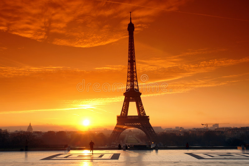Eiffel tower and jogger stock photos