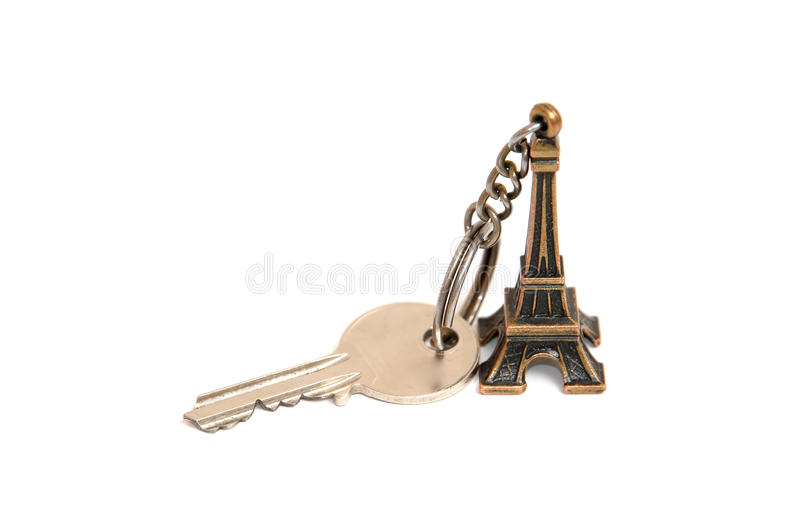 Eiffel tower key holder. And key isolated on a white background royalty free stock photography
