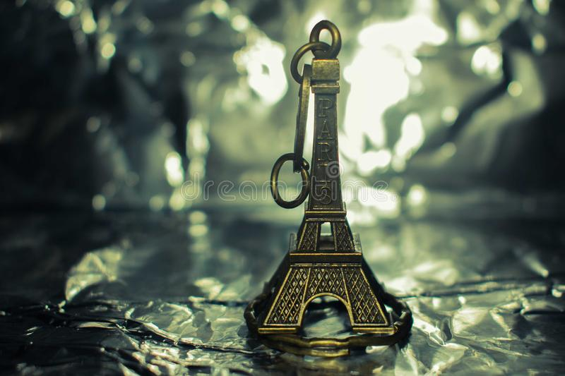 Eiffel tower keychain isolated on a silver background royalty free stock images