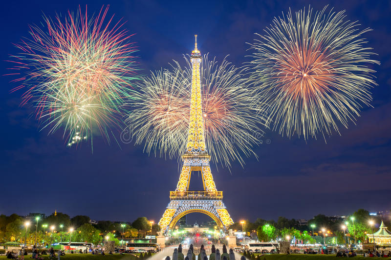 Eiffel tower light performance show and New Year 2017 fireworks in night. stock photo