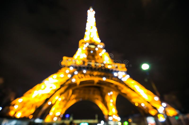 Eiffel Tower light performance show in twilight. Abstract background with lights and bokeh. Blurred defocused illuminated beam at dusk. Night urban view stock image