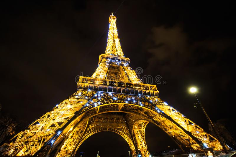 Eiffel Tower light performance show in twilight. Paris, France. Abstract background with lights and bokeh. Illuminated beam. Night urban view. Touristic royalty free stock photography