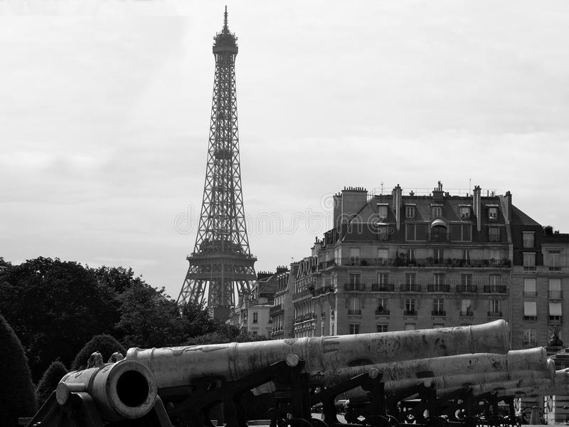 Eiffel Tower with Military Cannons stock images