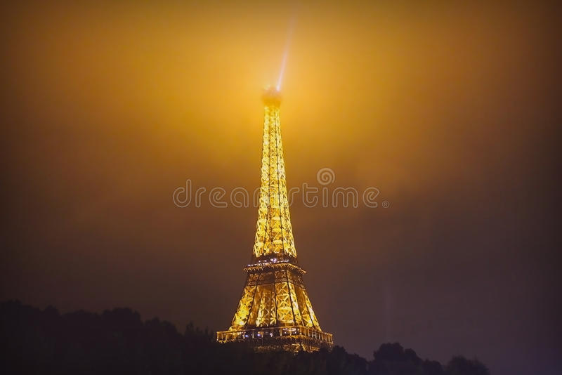 eiffel tower at misty night in paris france editorial photography image of metal attraction. Black Bedroom Furniture Sets. Home Design Ideas