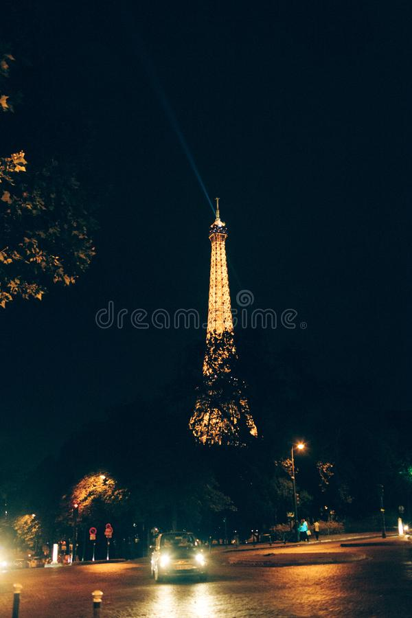 Eiffel Tower night with car stock image