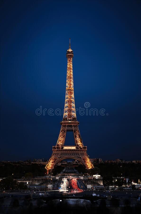 Eiffel Tower in night. Famous historical landmark on the quay of a river Seine. Romantic, tourist, architecture symbol. Toned. 24.04.2018 PARIS, FRANCE stock photos