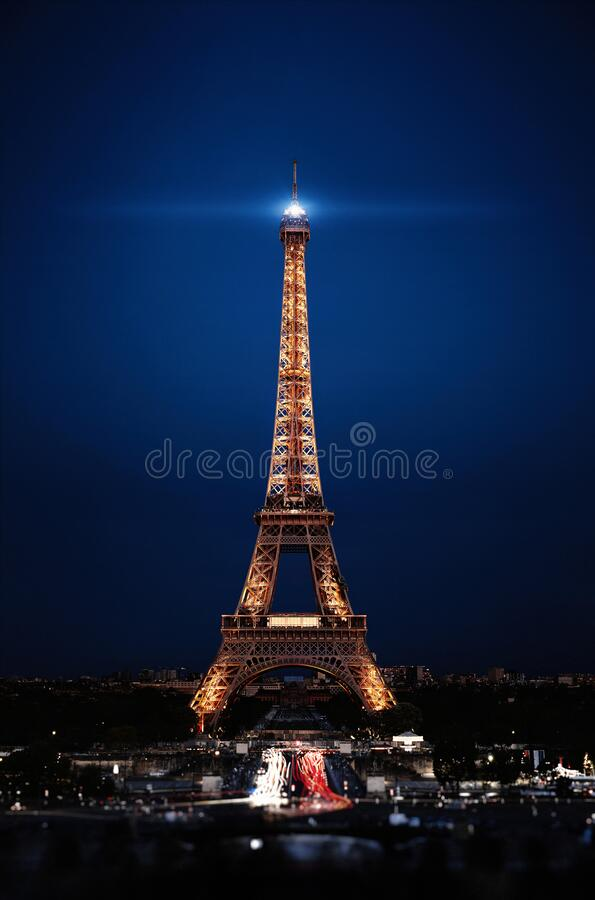 Eiffel Tower in night. Famous historical landmark on the quay of a river Seine. Romantic, tourist, architecture symbol. Toned. 24.04.2018 PARIS, FRANCE royalty free stock images