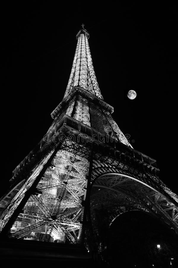 Eiffel Tower at Night with Moon stock images