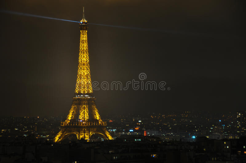 The Eiffel Tower at night viewed from Arc de Triomphe, Paris, Fr stock image