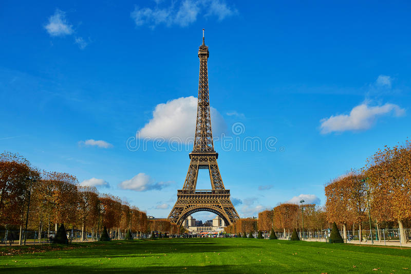Eiffel tower over blue sky. Sunny autumn day in Paris stock image