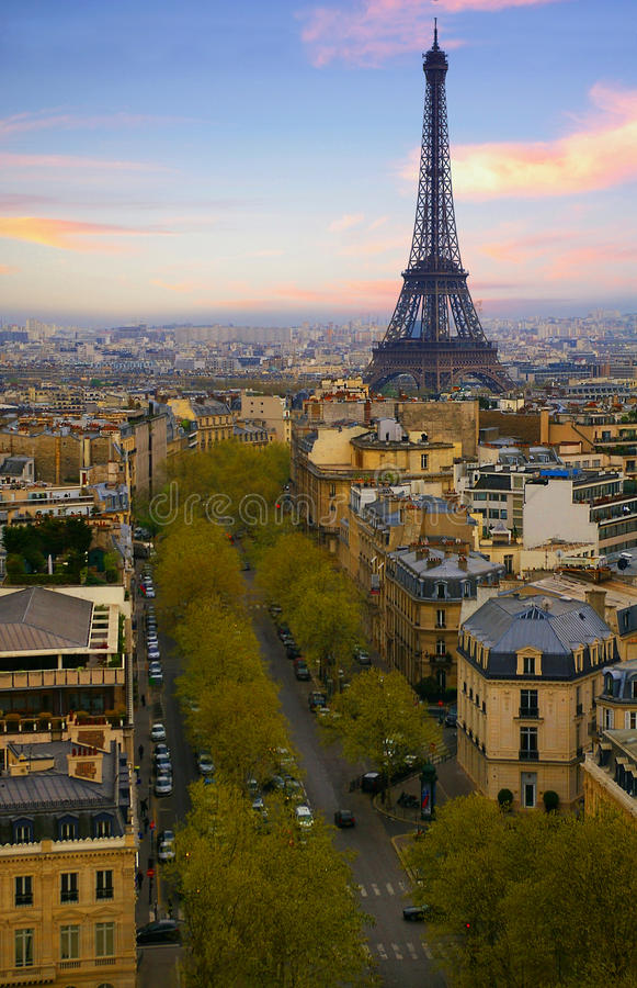 Eiffel Tower and Paris Skyline at sunset. Colorful sunset with the Paris skyline and the Eiffel Tower. View from the Champs Elysees and Arc de Triomphe royalty free stock photography