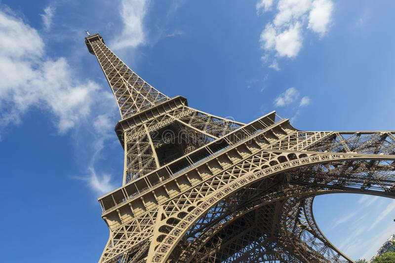 The Eiffel Tower, a wrought-iron lattice tower on the Champ de Mars in Paris, France. The Eiffel Tower, photographed on an angle, is a wrought-iron lattice tower stock image