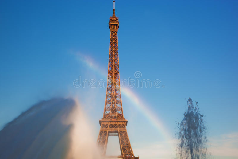 Eiffel Tower seen from fountain making natural rainbow, Paris, France royalty free stock images