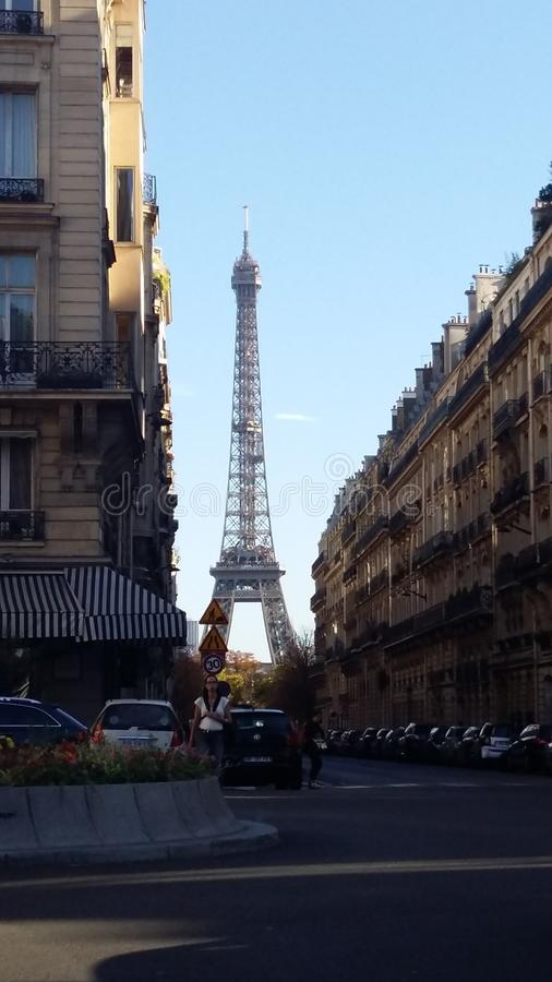 Eiffel Tower seen it by one of Paris` Streets. Charming city royalty free stock photography