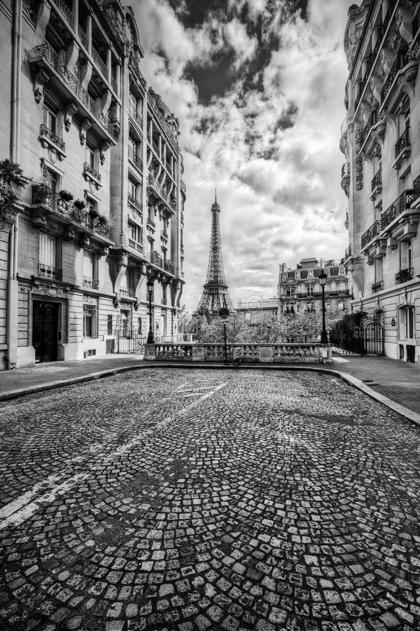 Eiffel Tower seen from the street in Paris, France. Black and white stock images