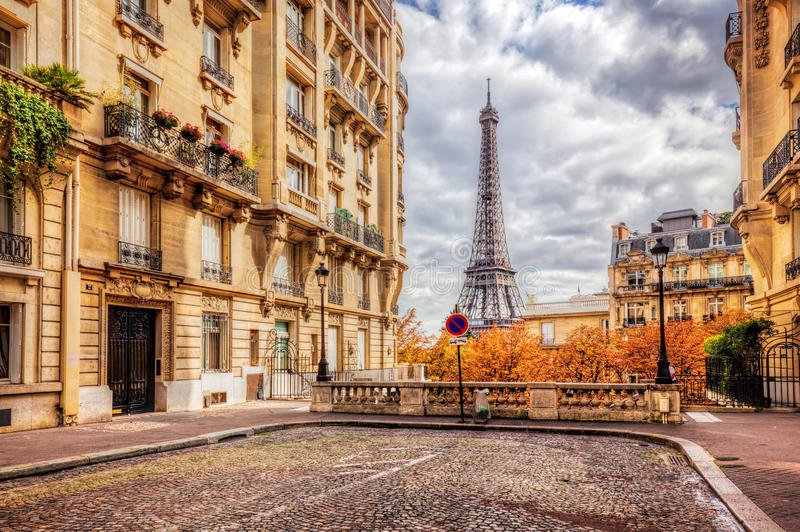 Eiffel Tower seen from the street in Paris, France. Cobblestone pavement stock images