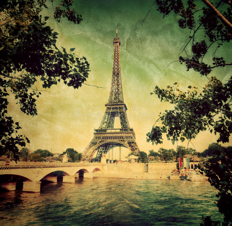 Eiffel Tower and Seine river in Paris, France. Vintage royalty free stock photos
