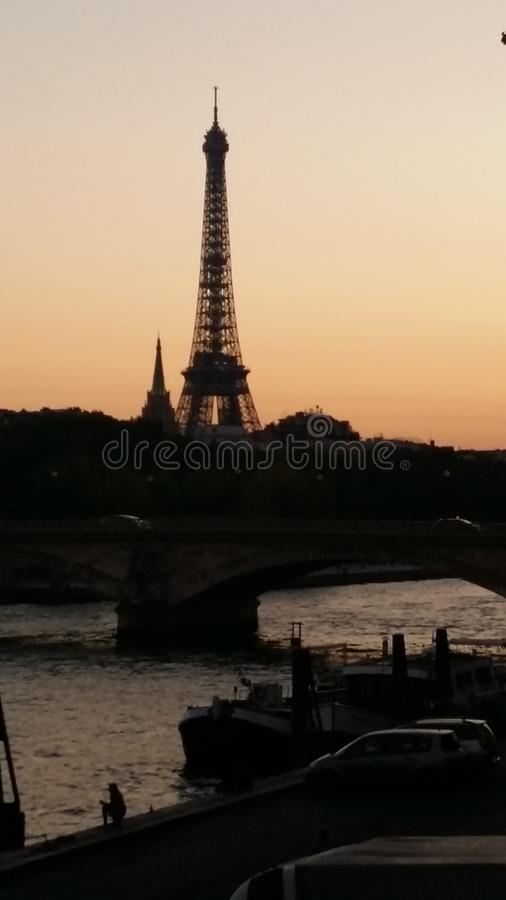 Eiffel Tower, Sena river sunset view, light city shinning bright like a diamon royalty free stock image