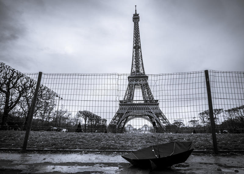 Eiffel tower and umbrella on a rainy day stock photo