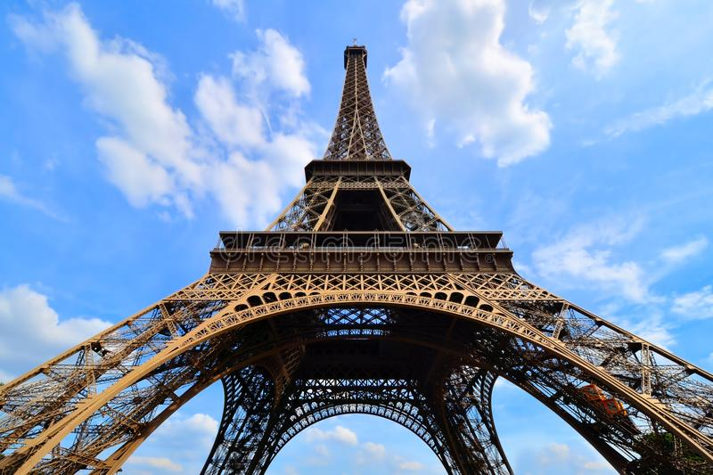 Eiffel Tower upward view under blue skies, Paris, France. Iconic Eiffel Tower, Paris, France upward view with vibrant blue sky royalty free stock photos