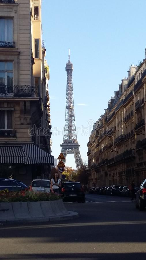 Eiffel Tower view from one of the little streets in Paris, 2017 royalty free stock photography