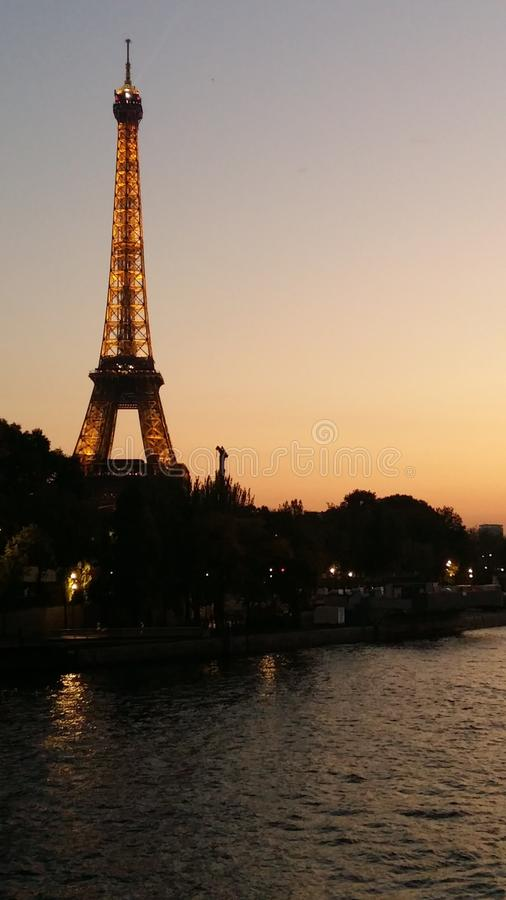 Eiffel Tower view from Siena River, shining during the sunset royalty free stock photos