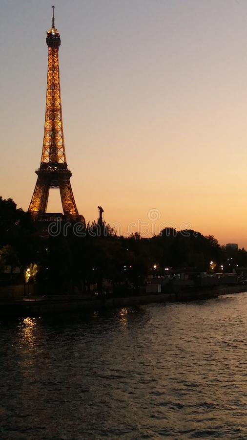 Eiffel Tower, view from Siena River at Sunset royalty free stock photos