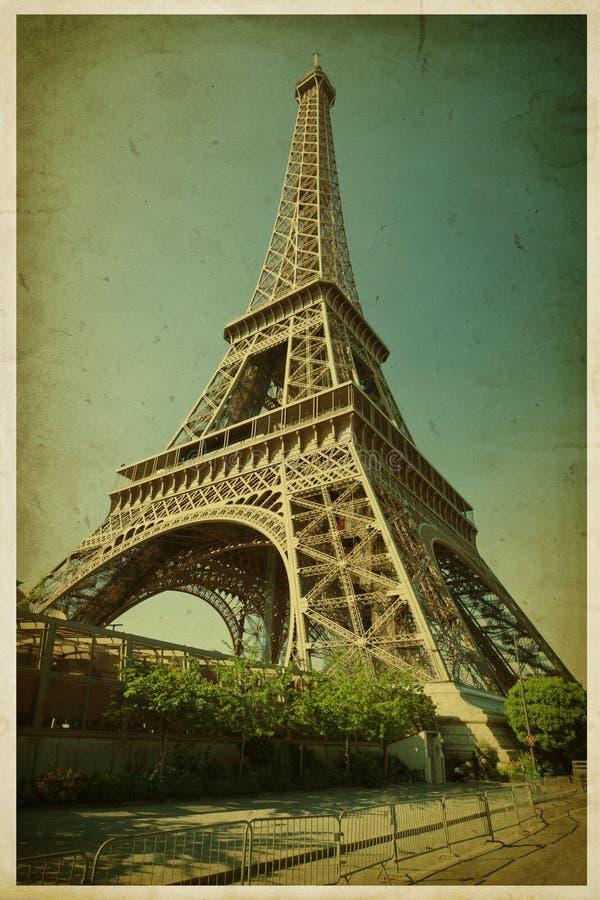 Eiffeltorn. Foto i retro stil. Pappers- textur. arkivfoton