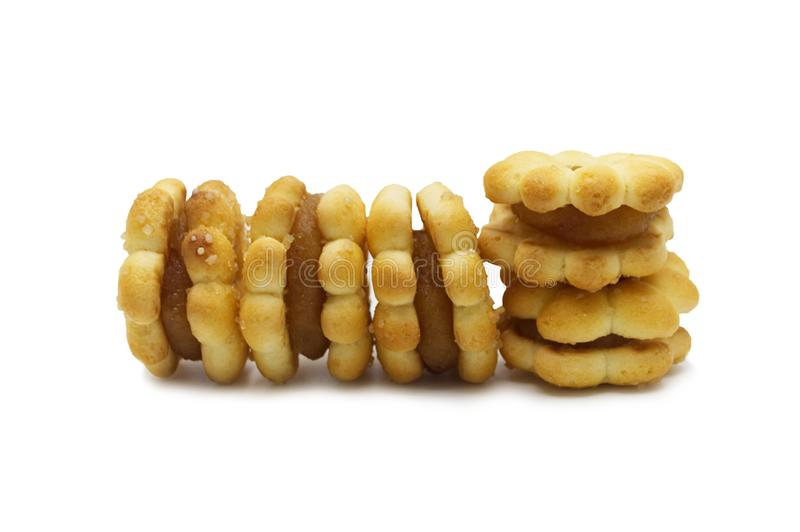 Eigengemaakte koekjescracker Op smaak gebrachte ananasjam en snoepje Bloemenontwerp stock fotografie