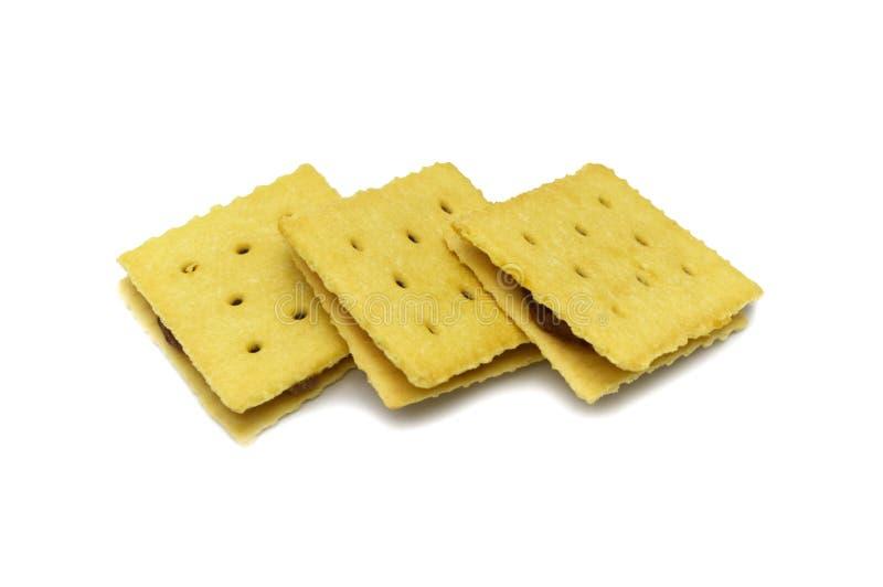 Eigengemaakte koekjescracker Op smaak gebrachte ananasjam en snoepje Vierkant ontwerp stock foto's