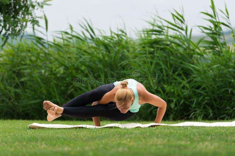 Eight angle pose Astavakrasana Yoga royalty free stock photos