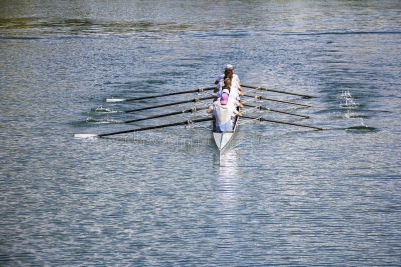 Eight men rowing stock image