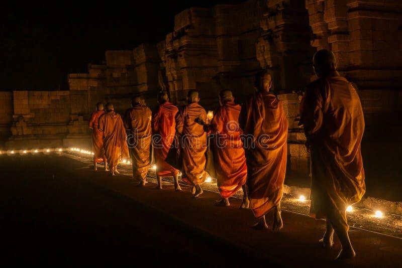 Eight monks walking stock photo