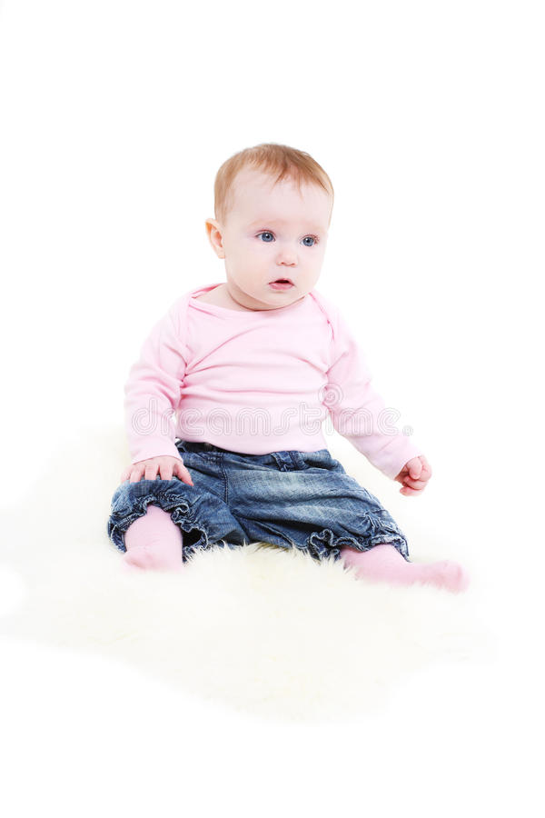 Download Eight-monthly Girl In A Pink Jacket And Jeans Royalty Free Stock Photos - Image: 20132288